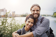 Portrait of smiling couple standing against river - MASF02940