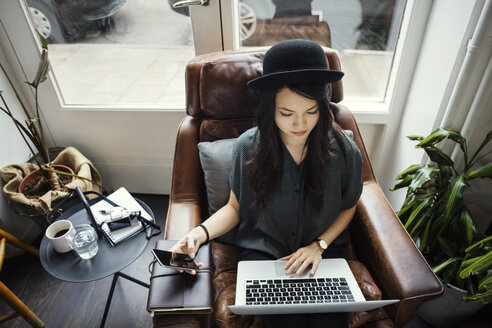 High angle view of creative businesswoman working while sitting on chair - MASF03086