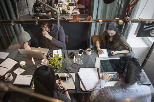High angle view of creative team working at table in office seen through glass - MASF03089
