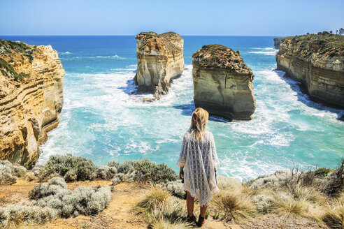 High angle view of woman looking at view at Loch Ard Gorge against clear sky - CAVF36546