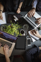 Directly above shot of creative people working at table in office - MASF03123