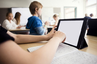 Cropped image of boy using digital tablet in classroom - MASF03147
