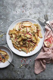 Directly above shot of pancakes with apple slices and pomegranate seeds - MASF03150