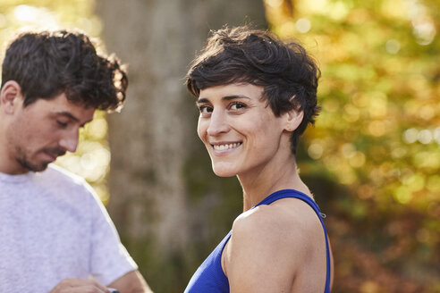 Couple during sport in forest - SHOF00029