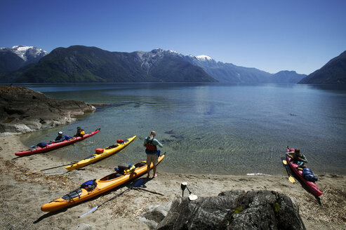 Friends with kayaks at lakeshore - CAVF36645
