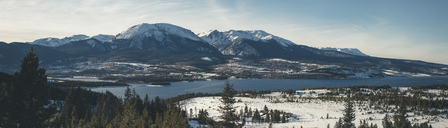 Panoramic view of river against mountains during winter - CAVF36951