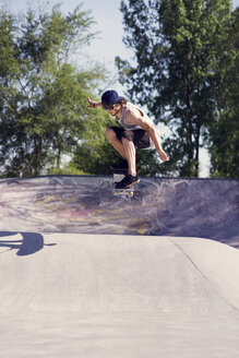 Young man doing skateboard trick on ramp - CAVF36996