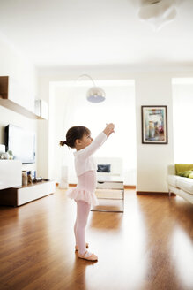 Side view of girl performing ballet dance at home - CAVF37185
