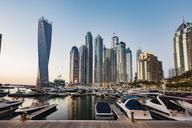 Modern buildings and harbor against clear sky - CAVF37500