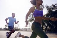 Couple jogging on street - CAVF37578