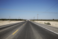 Highway on landscape against clear blue sky - CAVF37788