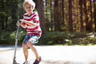Boy with push scooter - CAVF37848
