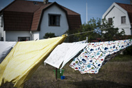 Wind blowing clothes hanging on rope in back yard - MASF03271