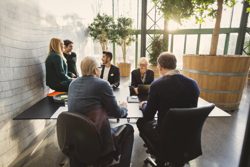 Team of creative business people discussing in office - MASF03280