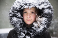 Portrait of girl wearing fur hood covered with snow - MASF03346