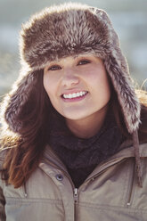 Portrait of happy women in warm clothing standing outdoors during winter - MASF03361