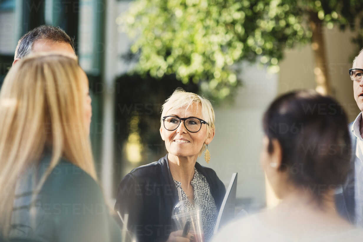 Mature businesswoman with colleagues in creative office - MASF03472 - Maskot ./Westend61