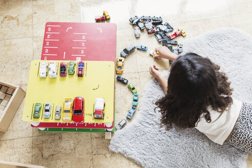 High angle view of girl playing with toy car in day care center - MASF03514