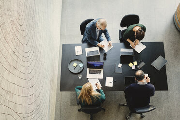 High angle view of multi-ethnic business people working at table in creative office - MASF03550