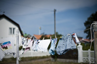 Clothes hanging on rope in back yard - MASF03718