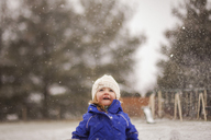 Happy girl enjoying snowfall - CAVF38366