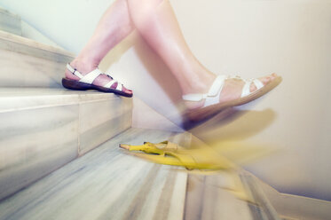 Woman slipping on banana peel on stairs - FRF00650