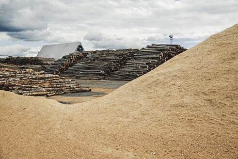 Stack of logs and shavings at lumber mill - MASF03902