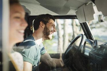 Side view of happy couple enjoying road trip - MASF03935