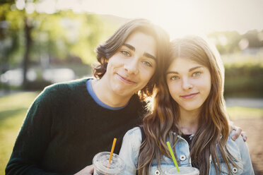 Portrait of smiling teenagers at park on sunny day - MASF04073