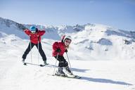 Man with daughter enjoying skiing on snowy mountain - MASF04172