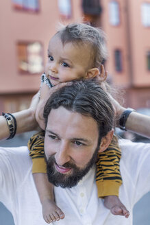 Mid adult man carrying son on shoulders outdoors - MASF04193