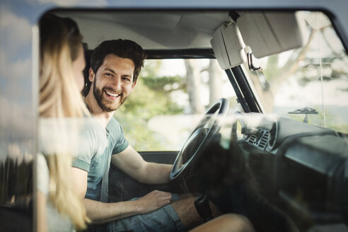 Happy man enjoying road trip with woman - MASF04267