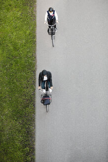 High angle view of business people riding bicycles on road - MASF04282