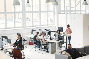 High angle view of multi-ethnic business people working in modern office - MASF04306