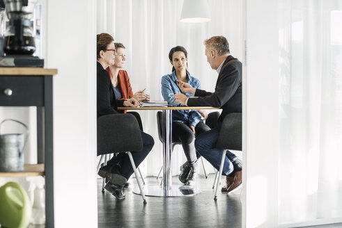 Businessman explaining business strategy to colleagues in meeting - MASF04486