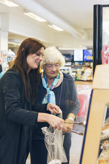 Young woman shopping with grandmother at supermarket - MASF04495