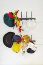Toys and hats hanging from hook in kindergarten - MASF04534