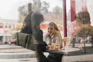 View of happy university students in cafe through glass - MASF04582