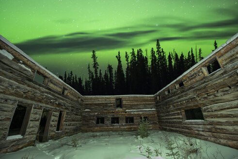 Majestic view of aurora borealis over wooden walls with windows - CAVF38643