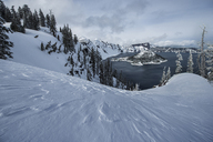 High angle view of Wizard Island at Crater Lake National Park during winter - CAVF38667