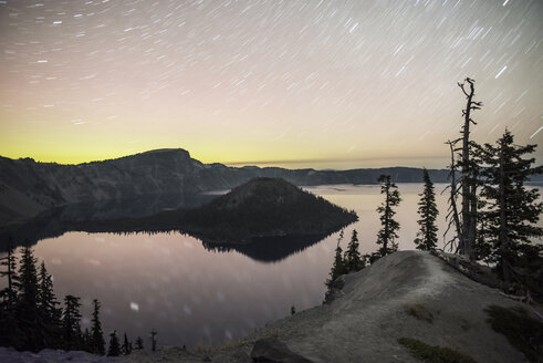 Scenic view of Crater Lake National Park against star trails during sunset - CAVF38742