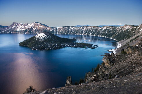 Scenic view of Wizard Island amidst Crater Lake against sky - CAVF38754