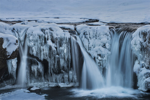 Scenic view of waterfall during winter - CAVF38988