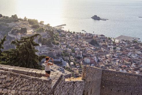 Greece, Peloponnese, Argolis, Nauplia, Argolic Gulf, woman photographing view to Bourtzi Castle - MAMF00027