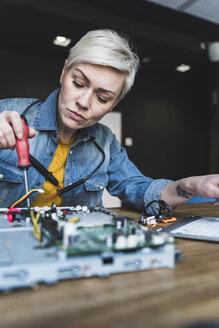 Woman working on computer equipment - UUF13389