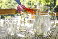 Glass jar and glass of water on table - MAMF00046