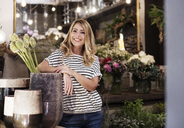 Portrait of smiling florist in flower shop - CAVF39834