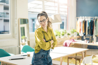 Portrait of smiling fashion designer in her studio - MOEF01022