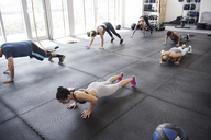 High angle view of athletes doing push-ups in crossfit gym - CAVF40278