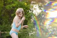 Playful girl at backyard - CAVF40311